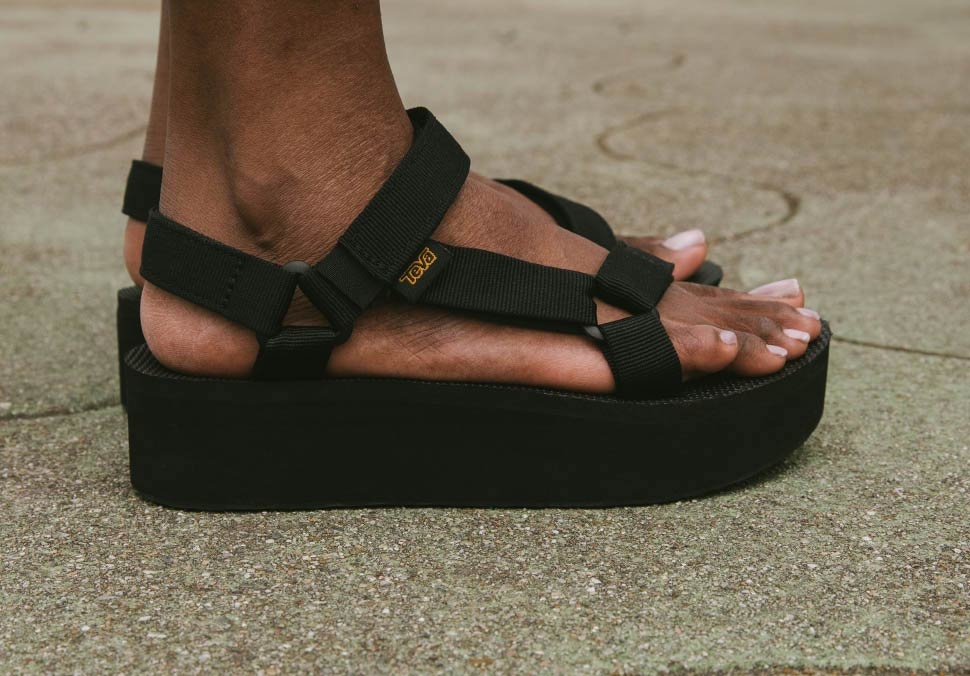 Close up of a woman's feet wearing Teva Flatform Sandals.
