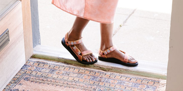 Close up of a woman's feet wearing Teva sandals.