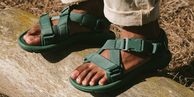 Close up of a man's feet wearing Teva sandals.